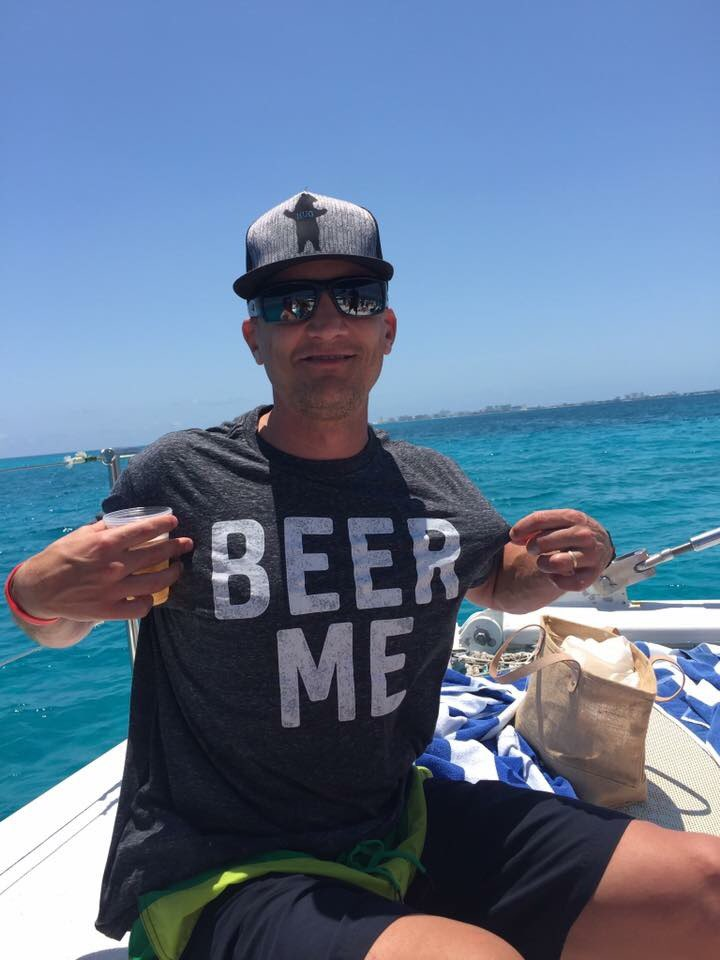 Larry Quisel wearing his BEER ME shirt